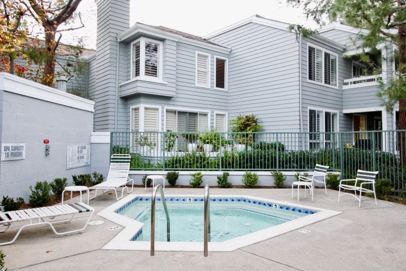 A great day in the Bayridge with a swimming pool in front of an apartment.