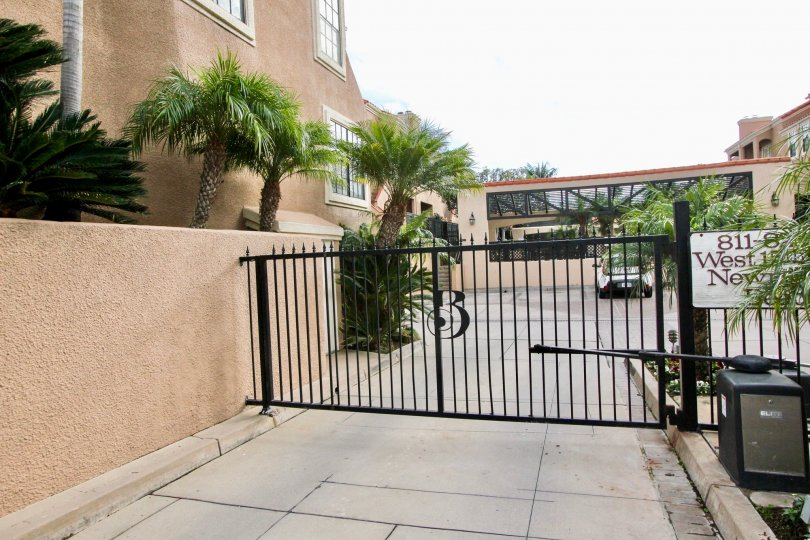 a warm day in the brookview ll with house that has parking car and out way gate