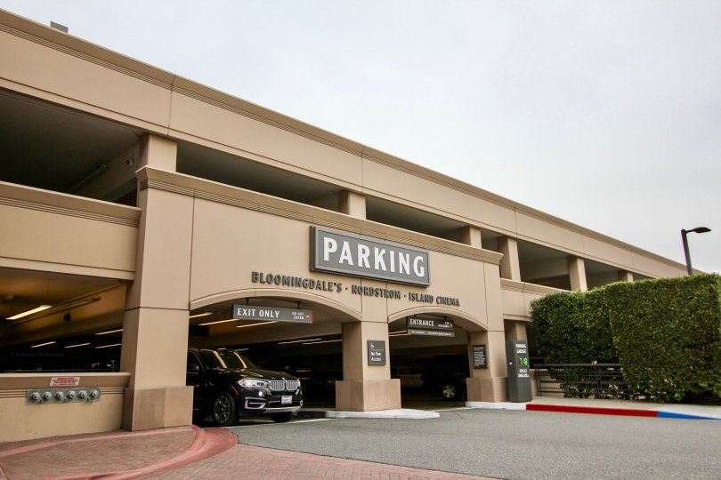 Car exiting parking garage at Meridian shopping center in Newport Beach, CA