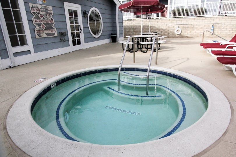 Inside the Villa in Newport Knolls has Children's Swimming Pool with Chairs and dinning tables