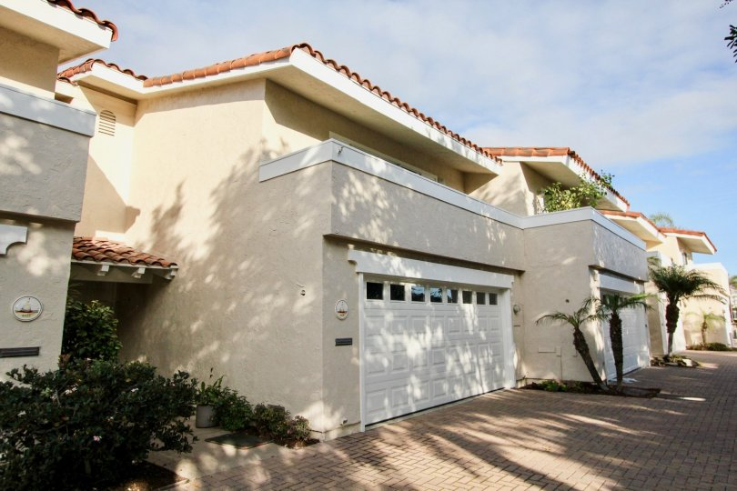 Sideview with garage door and open space of Newport Marina Villas community, Newport Beach, CA