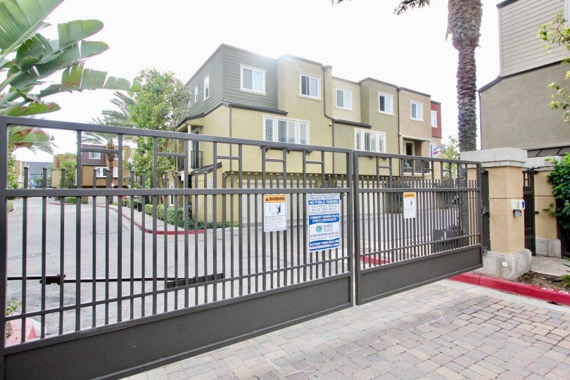 Gated entry and building view at One Nautical Mile in Newport Beach, CA