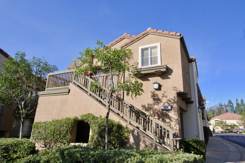 A beautiful big building and stairs in the Canyon Hills with a beautiful ornamental shrubs and trees.