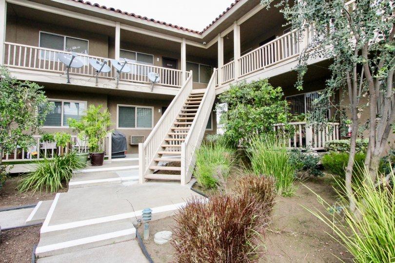A view of the Casa La Veta property, flush with landscaping, in Orange, CA.