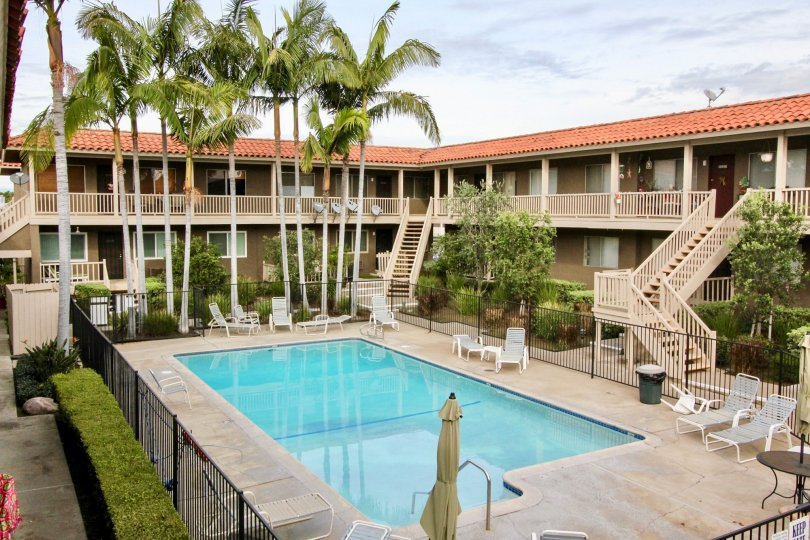 Pool and view of rooms with greenery at Casa Le Veta, Orange CA