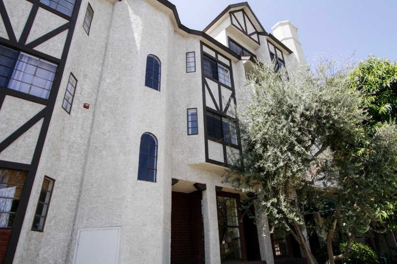 Tall white house with lovely exterior in Hampton Court, Orange California