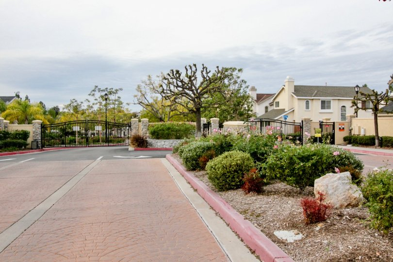 A gated street entrance outside the Huntington community on a cloudy day