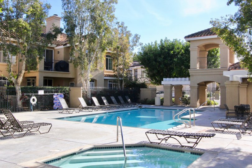 A great day in the Montevista with a swimming pool and chairs.