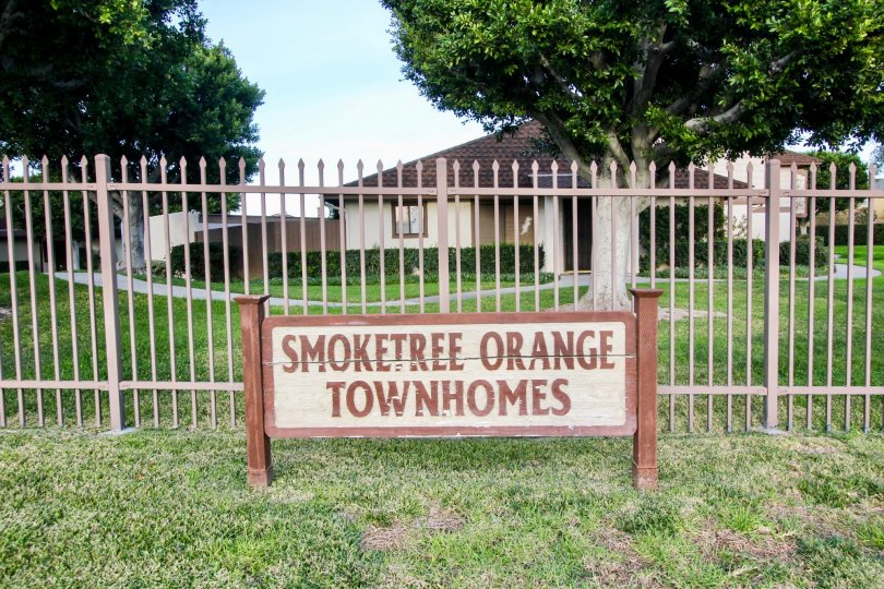 The sign to the Smoketree Orange Townhomes community in front of the lawn