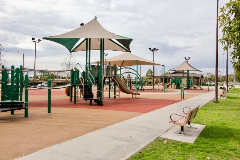 A large decked out playground on top of safety padded ground in Timber Hill at Orange CA