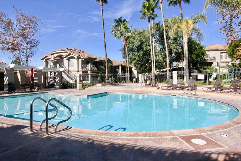 Chairs and pool at Belflora in Rancho Santa Margarita, CA