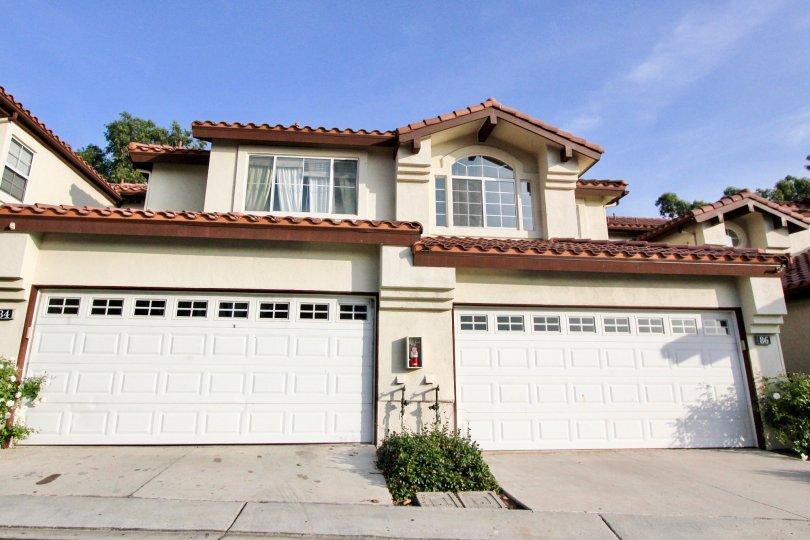 A big white and brown, to story house in the Rancho Santa Margarita neighborhood.