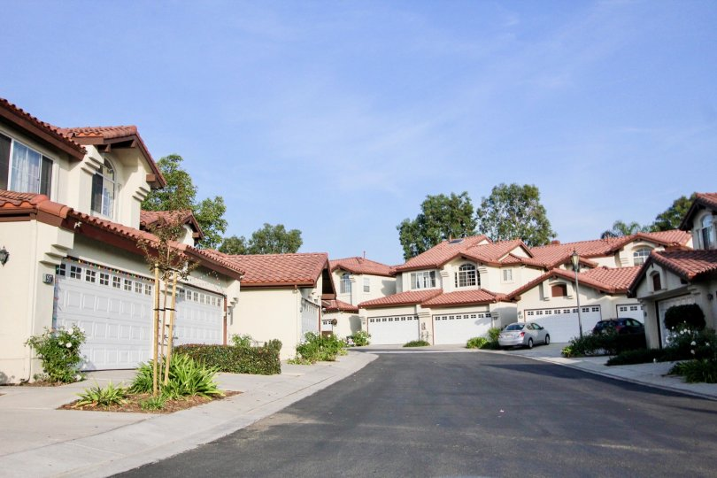 Multi family housing with tiled roofs and garages in the community of Candelero in Rancho Santa Margarita, California