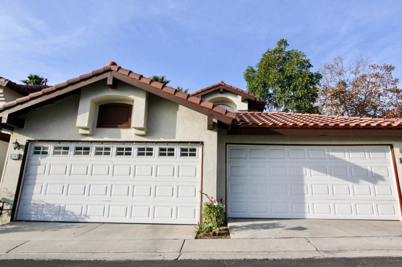 Two garage doors with a red roof in Candelero community in Rancho Santa Margarita, California.