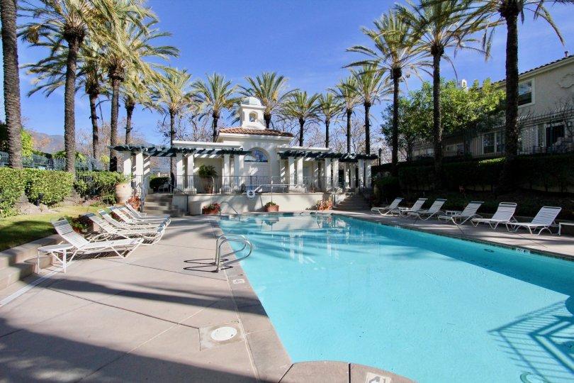 Twelve columns sit in front of a pool house at Cierra Del Lago