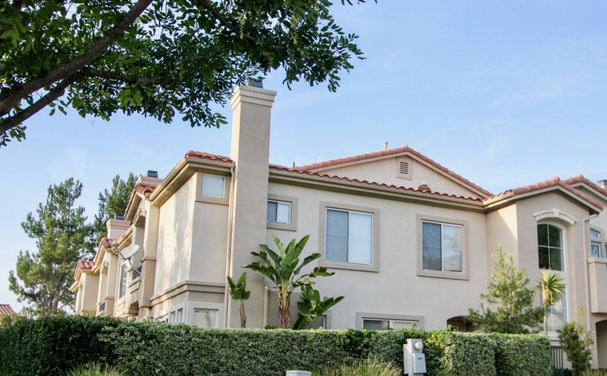 Hedges and apartment in La Ventana in Rancho Santa Margarita, CA