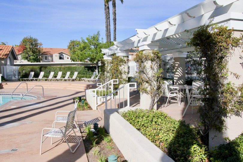 Chairs and pool at Las Flores in Rancho Santa Margarita, CA