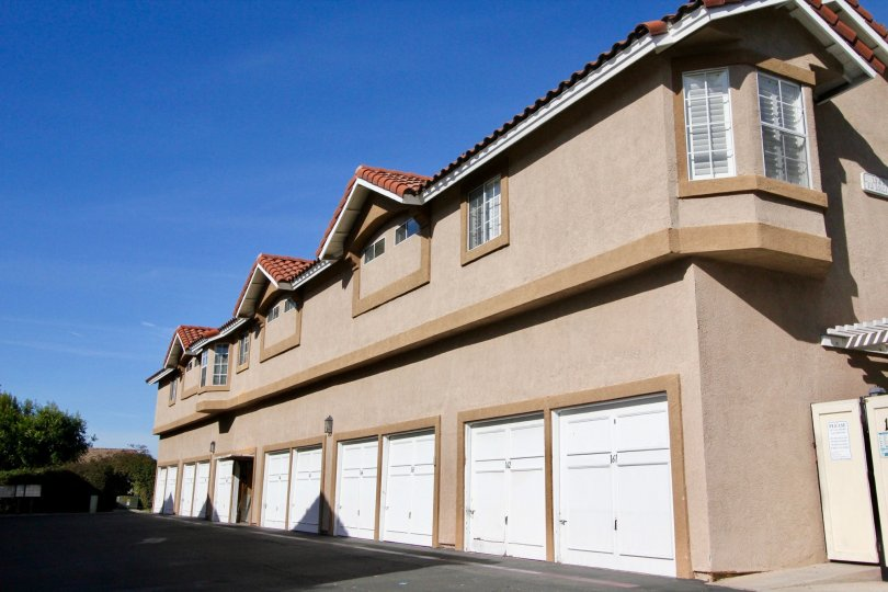 a two story building in the mission courts community, in Rancho Santa Margarita, CA