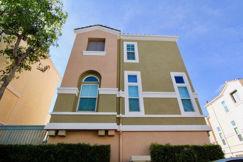 A three story colorful house in Montana Del Lago in Rancho Santa Margarita, CA