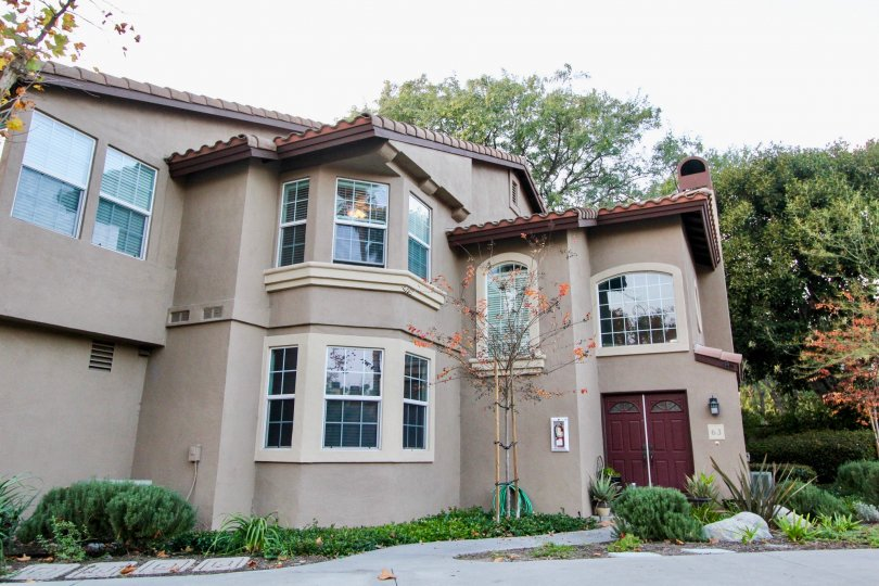 A brown house with red door in Serabrisa in Rancho Santa Margarita, CA