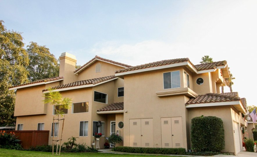 The Spanish syle residences at Sierra Verde with community landscaping and garage parking