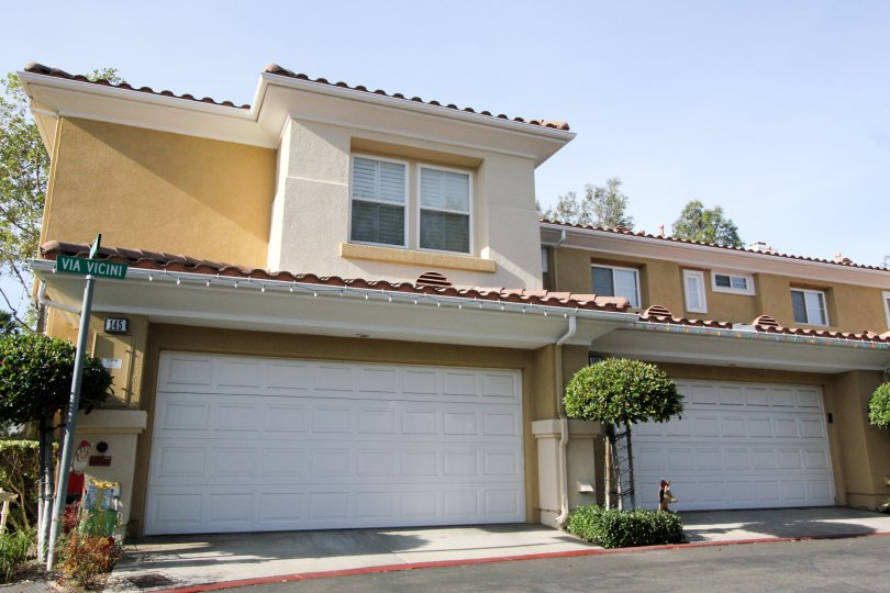 A street view of the two story, two car garage, Spanish style attached residences in the Terracina community
