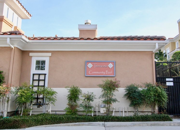 A sign sits on the wall at the Terracina condos community pool