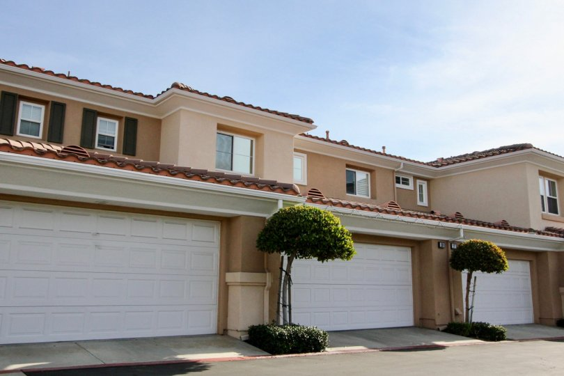 Multi family housing units with garages and tiled roofs in the community of Terracina in the City of Rancho Santa Margarita, California
