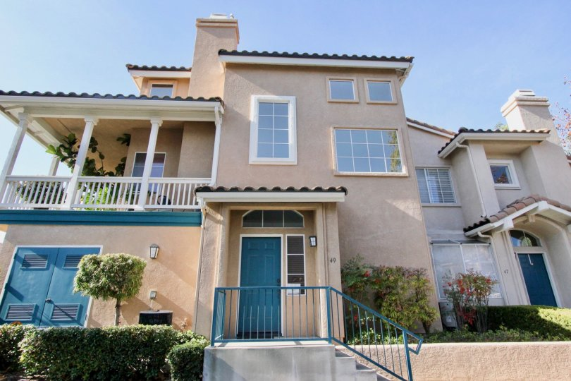 Majestic two story adobe styling with upstairs balcony at the Tierra Montanosa community