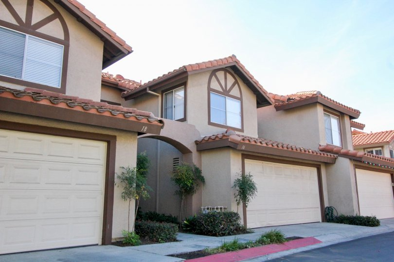 Street view of beige and brown town homes in Vista La Cuesta