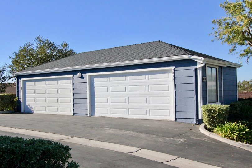 A two-car carport painted in blue in the Faire Harbour community.
