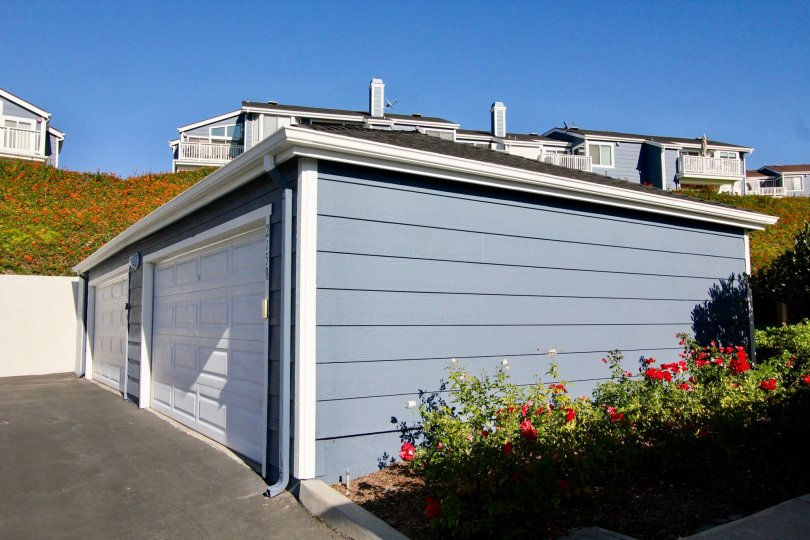 A closed two-car carport in the Faire Harbour community painted in blue.