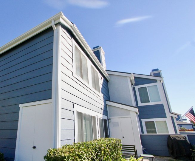 An upward view of a residence painted in blue in the Faire Harbour community.