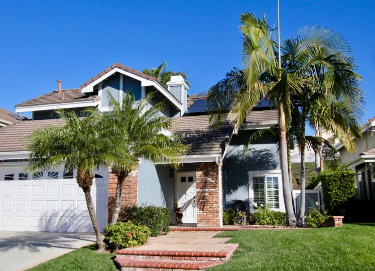 Fabulous green lawn with palm trees near villa in Highland Light Village of San Clemente