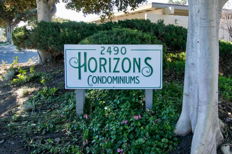 A name board of 2490 Horizons condominiums with a beautiful view.