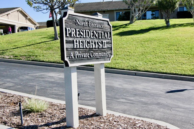 A sign board is placed in the President Heights II nearby the road.