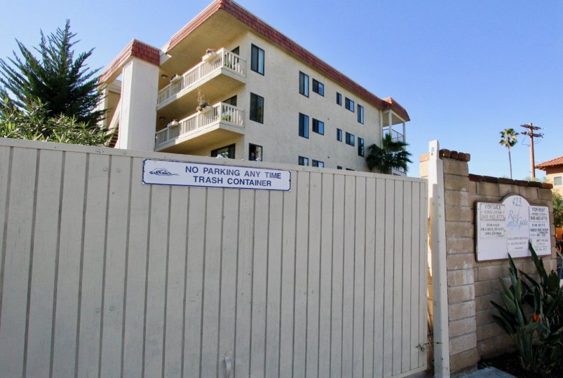 A view over a fence of apartment building in Reef Gate West.