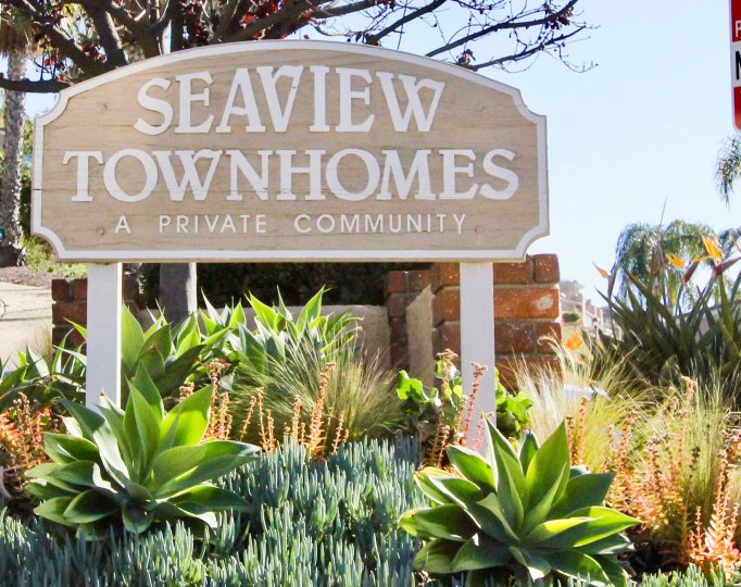 Variety plants with name board of Seaview Townhomes.