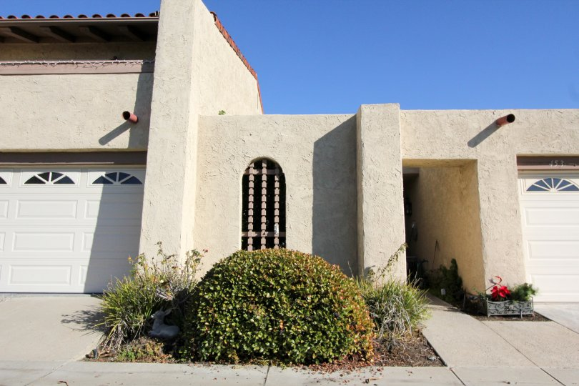 Distinctive entry and front view in true spanish adobe stying at the Summer Place community