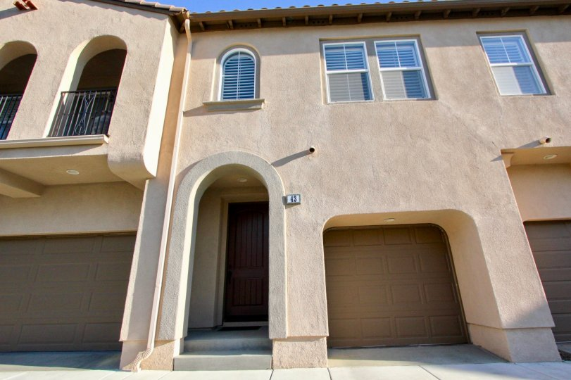Unique architectural style shows single car garages with private entryways at the Verano community