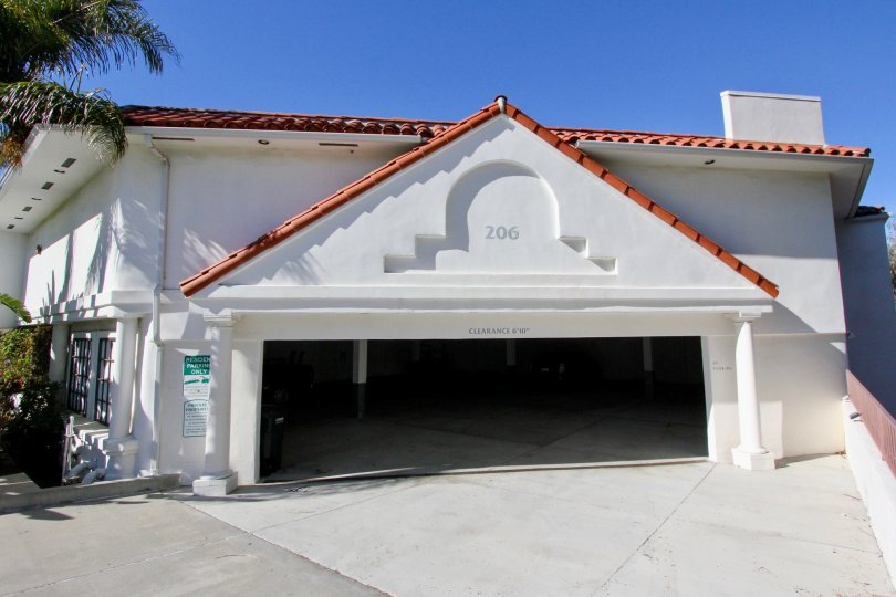 Three columns are visible behind an open garage door in Villa Montalvo Vista