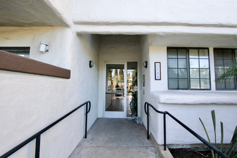 Vista Oceana, San Clemente, CA, An ADA accessible ramp down a white hall at address 3830