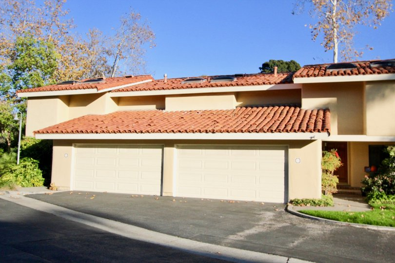 Accessable front garages adorned by adobe style roofs