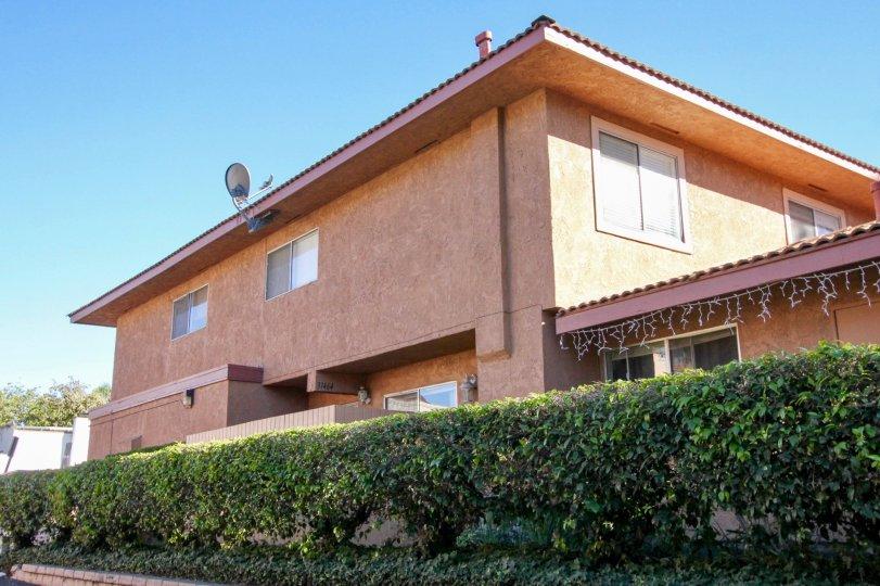 Blue skies and hedges in Capistrano Villas in San Juan Capistrano, CA