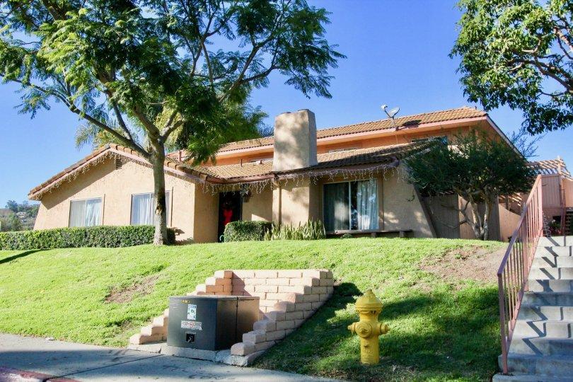 Hedges and blue sky above Capistrano Villas in San Juan Capistrano, CA