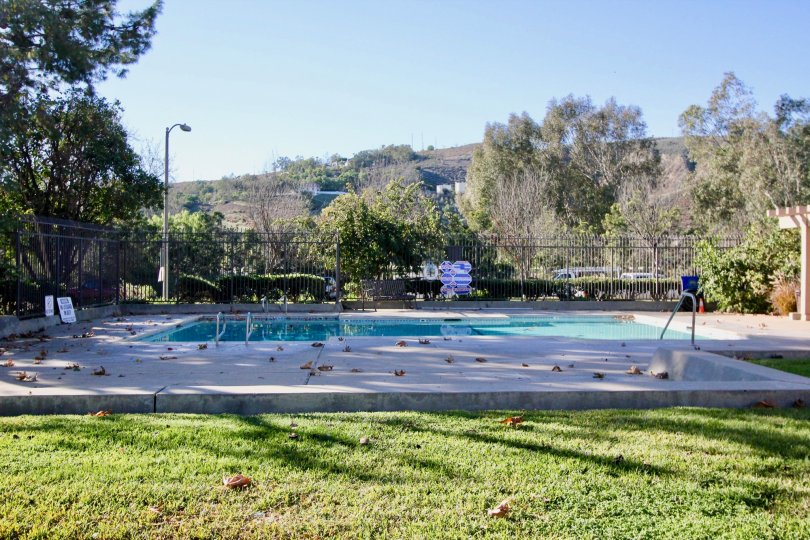 A view of the pool on a sunny day in Capistrano Villas.