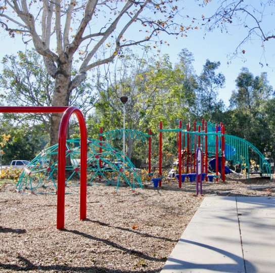 A sunny day in the Capistrano Villas where you will find a childrens playground, equipped with a jungle gym