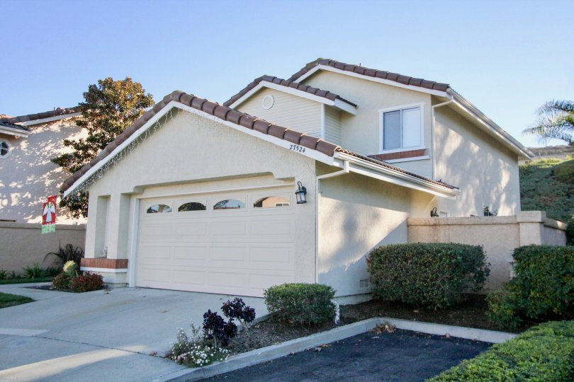 A white home with a garage at Loma Vista community in San Juan Capistrano, california.