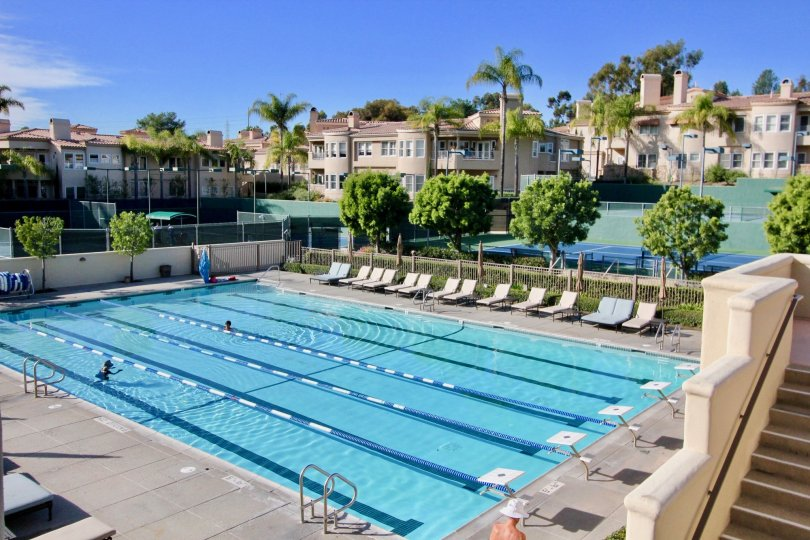 A very large pool with chairs and diving boards at Marbella Golf Villas community in San Juan Capistrano, California.
