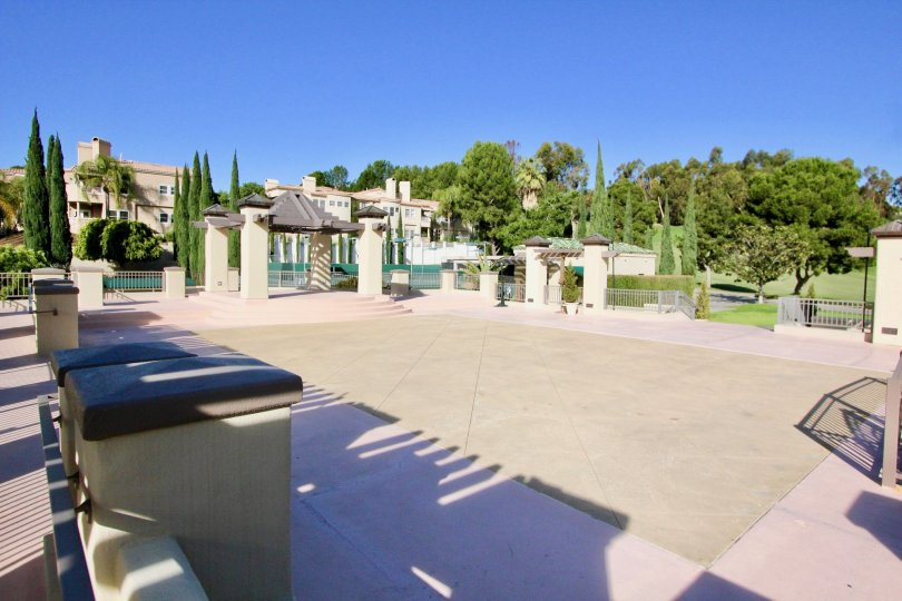 An empty patio is surrounded by fences at the Marbella Golf Villas